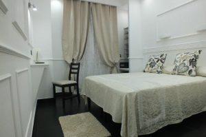 camera letto matrimoniale design bianco rome central inn